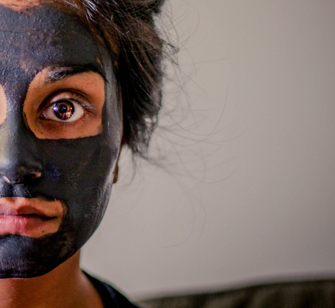 woman with face mask on staring at camera