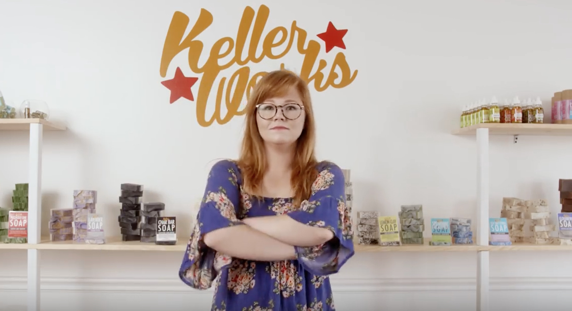 mom posing in front of all-natural eczema products by Keller Works