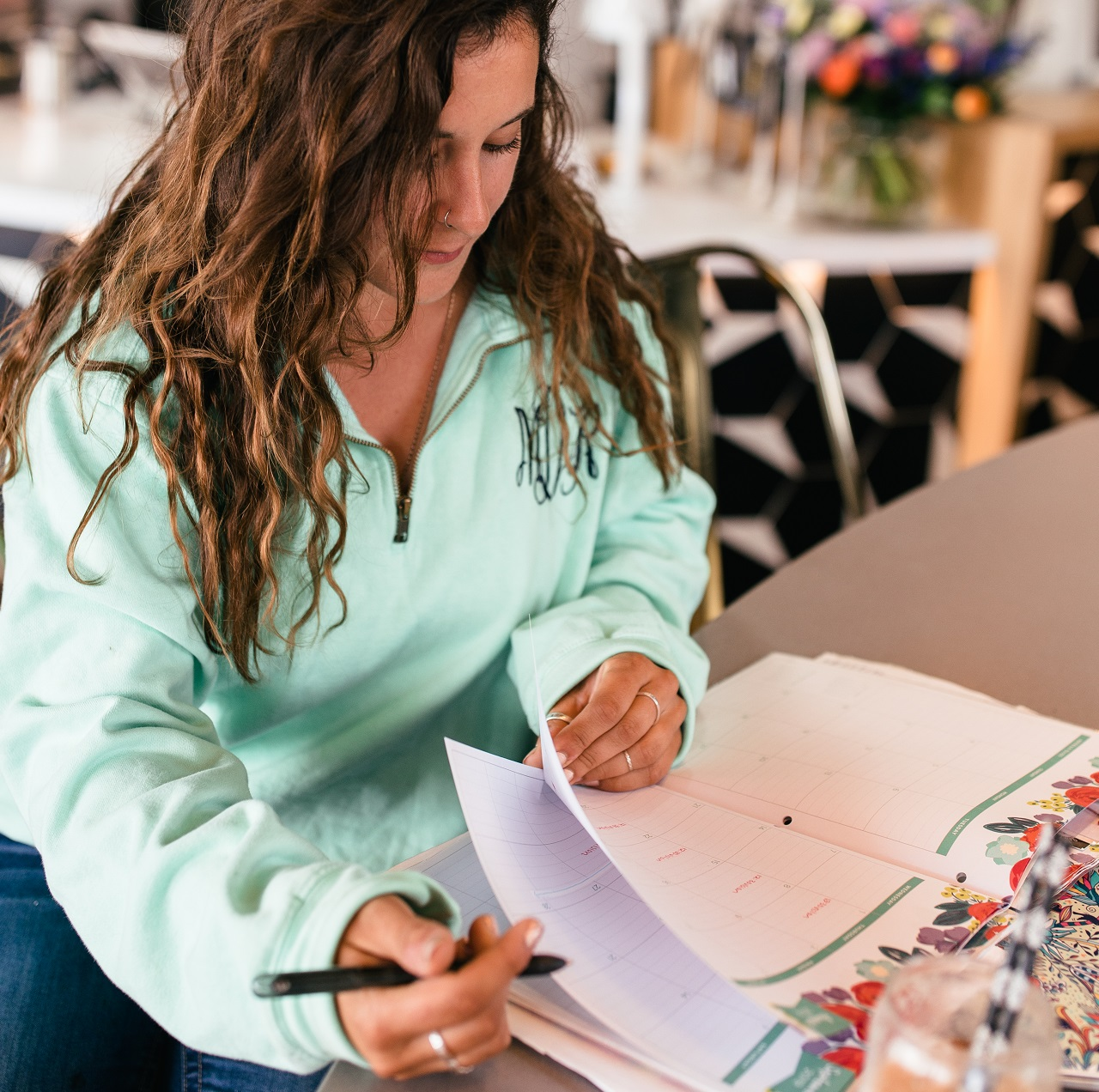 woman looking down at planner trying to get organized