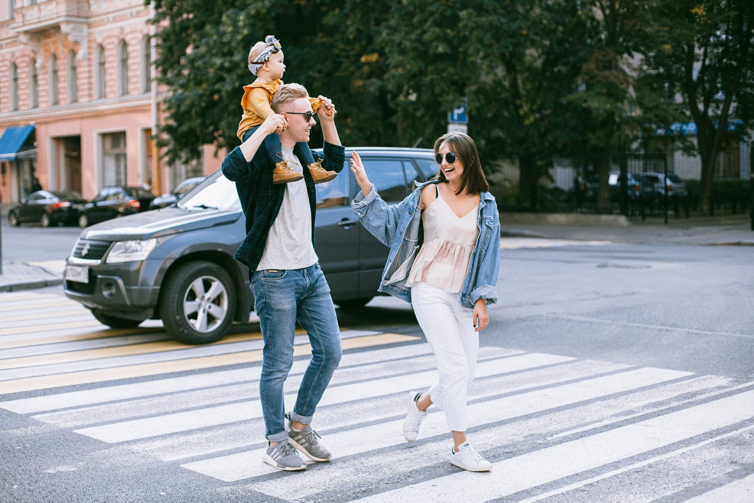 happy family crossing the street